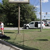 Staff photo by Harrison Grimwood<br /> Students from Northwest Oklahoma State University in Woodward wait with their belongings Wednesday after a tan Ford Expedition pulled out into traffic on Chandler Road near North David Lane, colliding with their Dodge minivan. There were no injuries. The driver of the Expedition, Brandon Drywater, 26, was cited for failure to yield to oncoming traffic, Muskogee Police Officer Bob Lynch said.