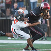 Special photo by Von Castor<br /> Wagoner's Nikia Jones fights off the tackle of Coweta's De'Shaun Diaz during the Bulldogs' 32-7 win on Friday in Wagoner.