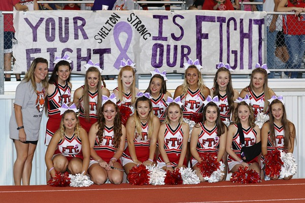 Special photo by John Hasler<br /> Fort Gibson Tigers cheerleaders wear purple hair ribbons at Friday night's game in a show of support for their classmate Jaren Shelton, who wears the mascot costume. He is fighting testicular cancer.