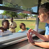 Staff photo by Cathy Spaulding<br /> Rougher Alternative Academy junior Reese Gas- saway, right, takes food orders from Peyton Chairs, left, and Shonta Mata, third from left. Gassaway helped Family Career and Community Leaders of America cook and serve ribs and pork during RAA parent-teacher conferences.