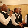 Staff photo by Harrison Grimwood<br /> Pastor David Ragsdale Jr. and the Mount Zion Baptist Church men's chorus lead congregants of the Berean Seventh-day Adventist Church in song while the adventist church celebrates its centennial anniversary.