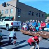 Photo by Wendy Burton<br /> Children scramble to grab candy and treats tossed from a float during the 64th annual Cherokee National Holiday parade on Saturday in Tahlequah.