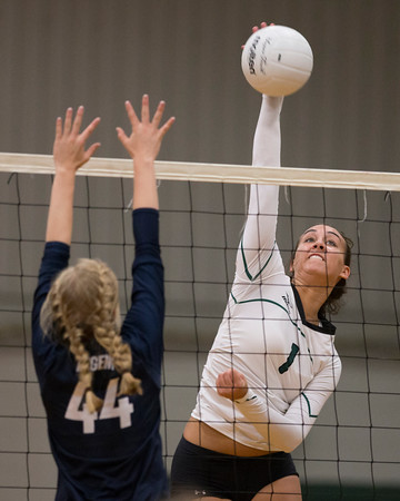 Special photo by Von Castor<br /> Muskogee's Claire Farmer goes up for a kill against a Regent defender in Saturday's final of the MHS Invitational tournament at Muskogee High School.