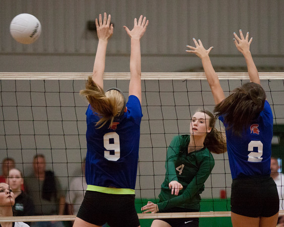 Phoenix special photo by Von Castor<br /> Muskogee's Madison Wiebe spikes the ball past two Bixby defenders in the first set of a 3-2 loss Tuesday evening.