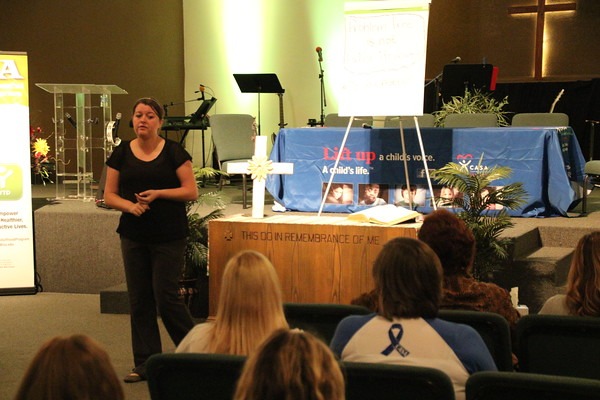Staff photo by Harrison Grimwood<br /> Oklahoma Successful Adulthood Program spokeswoman Meggan Winland-Clickner presents the program to CASA volunteers and foster care allies during a Wednesday morning panel.