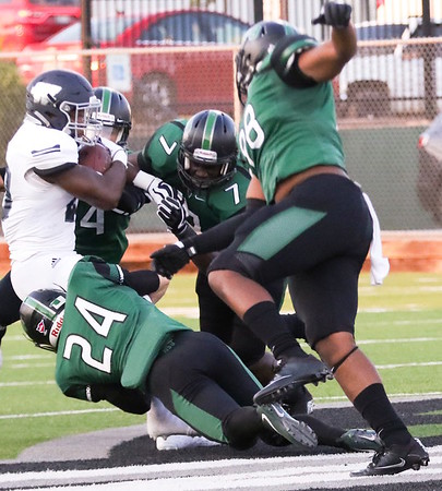 Phoenix special photo by John Hasler<br /> Northeastern State's Devon Siers, a Eufaula grad, and the RiverHawk defense shutdown Washburn running back Curtis Whitten in Thursday's season opener in Tahlequah.