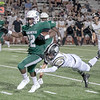 SHANE KEETER/Muskogee Phoenix<br /> Muskogee's Caleb Webb outruns the attempted tackle by McAlester's Lane Jarrett during Friday's season opener on Creek Nation field at Indian Bowl. The Roughers won 35-14.