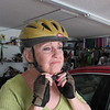 Staff photo by Cathy Spaulding<br /> Janet Thornton keeps herself safe by putting on a helmet before riding her bike.