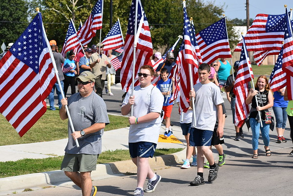 Staff photo by Mark Hughes<br /> Participants in the 9/11 Walk to Remember exit the parking lot at the Dr. Martin Luther King Jr. Community Center at 300 W. Martin Luther King St. on Saturday afternoon. Jeremy Luther, a Navy veteran, said the walk meant a lot to him because he joined the military specifically due to the Sept. 11, 2001 terrorist attacks.