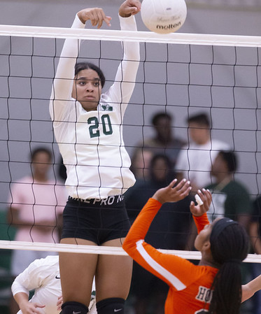 Muskogee's Mya Williams scores against Booker T. Washington Tuesday evening at the Muskogee gym.