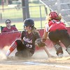 Phoenix special photo by John Hasler<br /> Hilldale's Madi Folsom, left, beats the tag of Okmulgee's Shawna Wilson at home to score in the third inningof the Lady Hornets' 11-0 run-rule win on Monday.