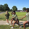 Staff photo by Cathy Spaulding<br /> Muskogee High School cheerleaders, including, Acelyn Archie, second right and Cherish Thompson, right, participate in a cross country event in memory of MHS graduate Maj. Ron Milam, who was killed in the 9/11 attacks.