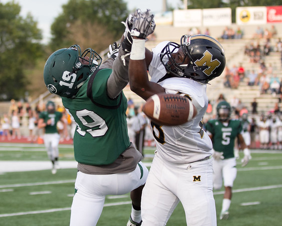 Phoenix special photo by Shane Keeter<br /> Muskogee's Eric Arnold, left, knocks a pass away from Midwest City's Dajon Sealey during the first game of the season. The Roughers host Bentonville (Ark.) West at 7 p.m. Friday on Creek Nation Field at Indian Bowl.