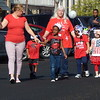 CATHY SPAULDING/Muskogee Phoenix<br /> Early Childhood Center pupils show patriotism with paper hats while marching along Broadway on Tuesday to mark 9/11.