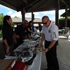 "KENTON BROOKS/Muskogee Phoenix<br /> Muskogee Fire Chief Mike O'Dell, right, dishes up food Tuesday while Lin Sacks of ServePro stands ready to help during the Muskogee Hotel and Lodging Association's event to honor the city's first responders in the Civic Center parking lot. Mark Patel, the MHLA president, said the event was ""in respect and appreciation of all the first responders for what they've done for the city and county of Muskogee. We want to give back to Muskogee."""