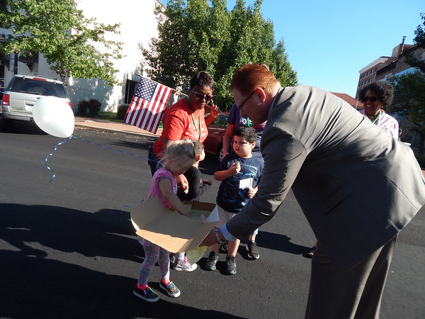 CATHY SPAULDING/Muskogee Phoenix<br /> Muskogee School Superintendent Jarod Mendenhall offers cookies to Early Childhood Center pupils who marched from their school Tuesday to honor 9/11.