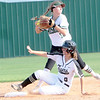 JOHN HASLER/Phoenix special photo<br /> Muskogee second baseman Brookelyn Gilmore fires a relay to first after forcing out Broken Arrow's Evie Herring in Tuesday's game.