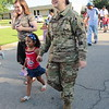 CATHY SPAULDING/Muskogee Phoenix<br /> U.S. Army National Guard member Cassidy Reed, right, holds hands with her niece, Nora Smith, Wednesday morning during the Early Learning Center's Patriotic Parade. Nora's mother, Bailey Smith, left, joins the walk.