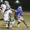 JOHN HASLER/Special to the Phoenix<br /> Checotah running back Dontierre Fisher looks to get around two Seminole defenders in a game last season.