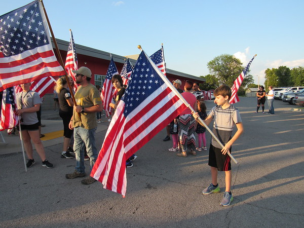 CATHY SPAULDING/Muskogee Phoenix<br /> Noah Luther, 11, of Muskogee adjusts his American flag before participating in the Walk to Remember 9/11.