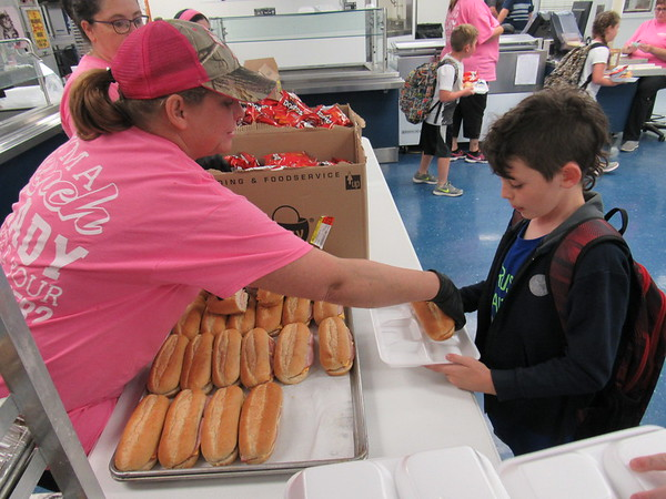 Staff photos by Cathy Spaulding<br /> Oktaha school cook Cheryl Battles gives fourth-grader Max Gray a sandwich during the school's afternoon nutrition program.