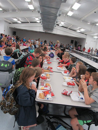 Staff photo by Cathy Spaulding<br /> Oktaha students have sandwiches, chips and milk during an afternoon meal.