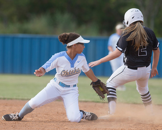 Phoenix special photo by Von Castor<br /> Oktaha's Mya Allen, left, stays with the tag as Beggs' Emma Mason over runs second base Tuesday afternoon at Oktaha. The Lady Tigers won 12-0.