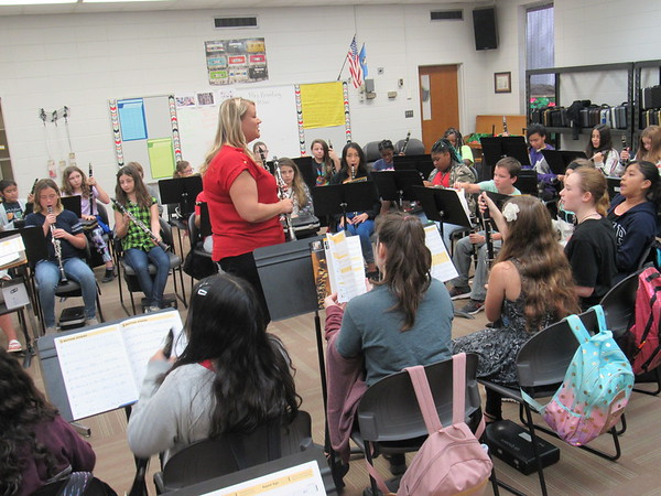CATHY SPAULDING/Muskogee Phoenix<br /> Beginning clarinetists surround band instructor Lindsey Breeding during a class at Muskogee Sixth Grade Academy. Some students must use borrowed instruments.