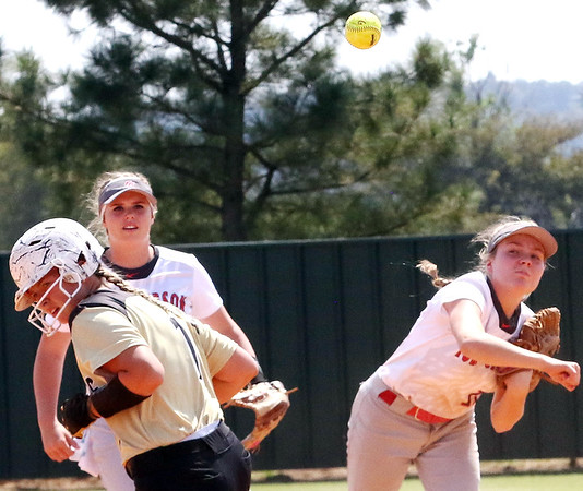 Phoenix special photo by John Hasler<br /> Fort Gibson's Maddi Jo Williams turns the second half of a double play as Abby Scott looks on in game one of a doubleheader with Broken Bow on Wednesday.