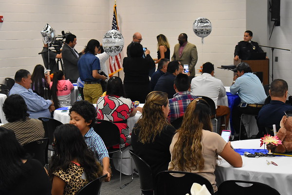 Staff photo by Mark Hughes<br /> More than 40 Hispanic residents graduated from the Muskogee Police Department Bilingual Community Academy at the Dr. Martin Luther King Jr. Community Center.