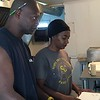 Staff photo by Mike Elswick<br /> Harry Roberts, left, owner of The Fish Hut, 452 W. Martin Luther King St., works on orders with Alexis Wallace in the establishment's kitchen. Roberts said he's ready to see action on revitalizing downtown Muskogee after years of talk.