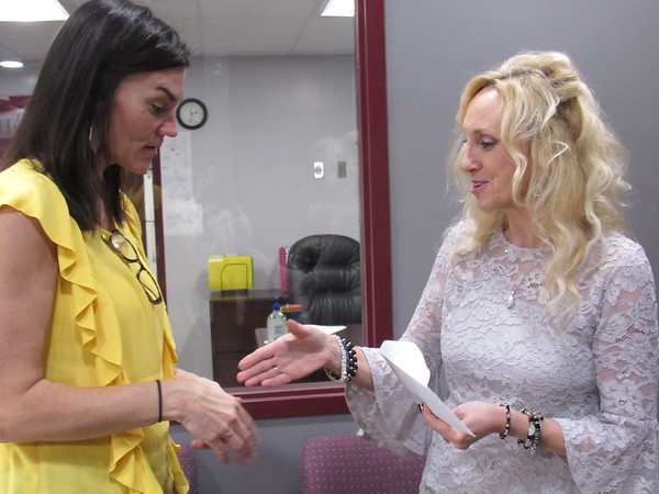 CATHY SPAULDING/Muskogee Phoenix<br /> Webbers Falls Elementary Principal Lisa Ward, right, offers her hand to ONEOK Foundation Executive Director Terri Pirtle after ONEOK presented the school with a $120,000 check to replace school items lost in late may floods.
