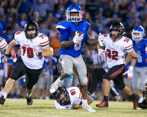 VON CASTOR/Special to the Phoenix<br /> Checotah's Dontairre Fisher breaks the tackle of Hilldale's Chance Johnson and outruns the rest of the Hornet defense to score in the first half Friday night at Checotah. Checotah beat Hilldale 35-28.