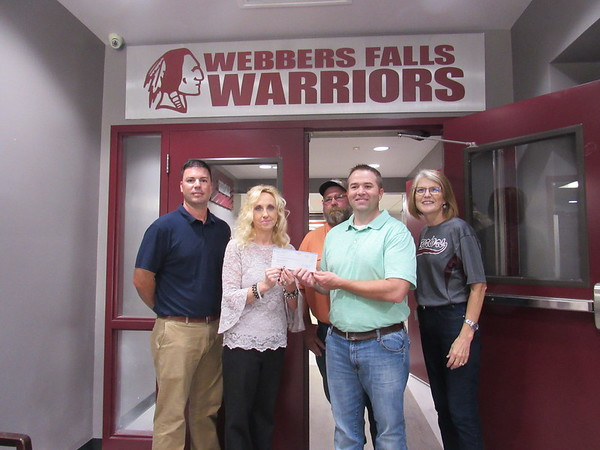 CATHY SPAULDING/Muskogee Phoenix<br /> Representatives of Webbers Falls School and ONEOK show a $120,000 check ONEOK presented to the school Friday. They are, from left, Assistant Principal Jordan Garner, Principal Lisa Ward, ONEOK pipeline employee Rick Denley, ONEOK Operations Manager Randy Mashburn and Webbers Falls Superintendent Dixie Swearingen.