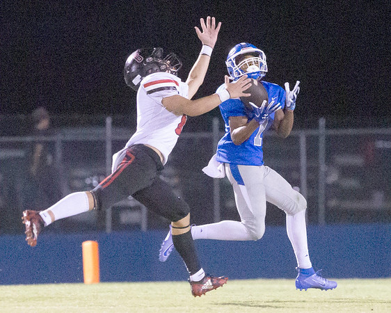 VON CASTOR/Special to the Phoenix<br /> Checotah's Malachi Harris intercepts a pass intended for Hilldale's Grayson Lawson during second half action Friday night at Checotah. The Wildcats beat the Hornets 35-28.