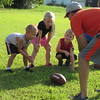Staff photo by Cathy Spaulding<br /> Upward Sports participants — from left, Sawyer Nixon, 5, Jayden Cotner, 5, and Kayden Wilhite, 5 — listen as Grandview Baptist Church Pastor Danny Mills discusses basics of football hiking.