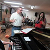 CATHY SPAULDING/Muskogee Phoenix<br /> New Life Assembly of God Pastor Lonnie Orman, center, practices music with pianist Mary Lou Disheroon and singer Sonya Elam.