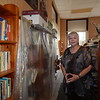 KENTON BROOKS/Muskogee Phoenix<br /> Nancy Brown, the literacy coordinator at the Carnegie Library in Wagoner, shows the plastic that is used to protect books because of a leaking roof. The library, built in 1912, has a list of problems: air conditioning does not work, stairs are rotting, plumbing in the restrooms needs repair, electricity is so bad that not all of the lights work, and no one rides the elevator because of water that has leaked onto the electrical wiring.