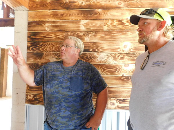 KENTON BROOKS/Muskogee Phoenix Owner Tom Jones, left, talks with contractor Garry McElmurry about his plans for the Patio on the Hill. Jones is converting an old barn into a multipurpose venue for weddings, dances, parties and other entertainment to be used weekly. The 40-acre property is at 1667 E. 100th St. N. in Wagoner County.