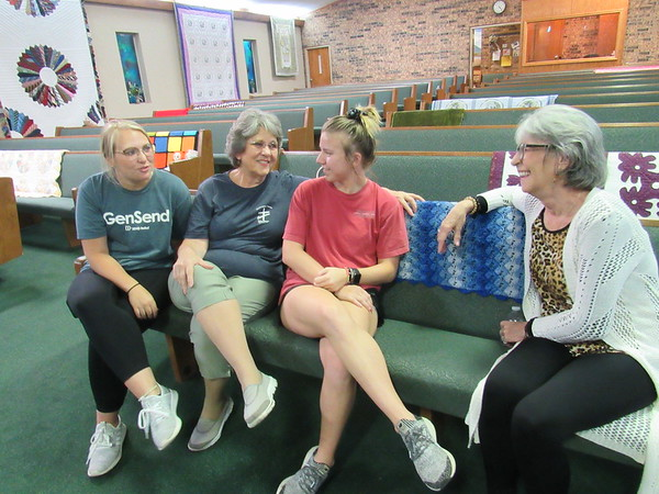 CATHY SPAULDING/Muskogee Phoenix<br /> Young and old members of Keefeton Trinity Baptist Church — from left, Julie Rogers, Bridget Croftcheck, Judy Croftcheck and Susan Boydstun Lewis — share memories of how the church has been a family. The congregation dates to 1934.