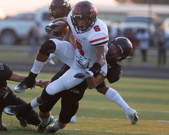 Phoenix special photo by Von Castor<br /> Hilldale's Devin Hembry is talked by Beggs' Easton Davis after a short gain during first quarter action Friday night at Beggs. The Hornets lost 34-12.