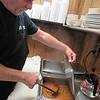 Staff photo by Cathy Spaulding<br /> Mike Withrow stirs chili at Speedway Grille. He said the restaurant has had the same chili recipe for more than 20 years.