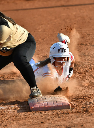 JIM WEBER/Special to the Phoenix<br /> Fort Gibson's Nia Polzin hustles back to first on a pick-off attempt against Broken Bow on Monday.