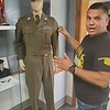 CHESLEY OXENDINE/Muskogee Phoenix<br /> Barracks founder Victor Lezama discusses a World War II-era uniform displayed in the recreation room at the upcoming veterans' center. Lezama and his crew hope to have the Barracks open by the end of October.