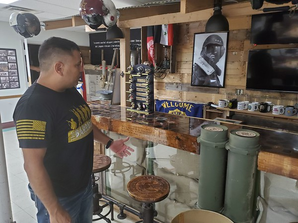 CHESLEY OXENDINE/Muskogee Phoenix<br /> Barracks founder Victor Lezama shows off the bar area in the kitchen of the upcoming veterans' center. The bar stools were engraved by the Muskogee High School Fab Lab.