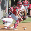 JOHN HASLER/Phoenix special photo<br /> Fort Gibson's Maddi Jo Williams beats a throw to Poteau catcher Piper Akins to score on Monday.