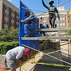 CATHY SPAULDING/Muskogee Phoenix<br /> Workers with Wilbert Memorials Tulsa, from left, Gary Mosier, Mic Hanson and Adam LeMaster, wrap a tarp around scaffolding Monday before doing sandblasting work on the Spirit of the American Doughboy statue at the Jack C. Montgomery VA Medical Center.