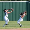 STEVE VAN WORTH/Phoenix special photo<br /> Muskogee shortstop Jordan Simmons, left, makes the grab of a fly ball in shallow center with second baseman Hannah Cawthon looking on. The catch began what wound up being a triple play against Sand Springs with Cawthon getting a tag out for the final out at second in a two-on, no out situation.