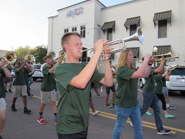 CATHY SPAULDING/Muskogee Phoenix<br /> Members of the Muskogee High School Pride of Muskogee band play the school fight song Tuesday during the Homecoming parade.