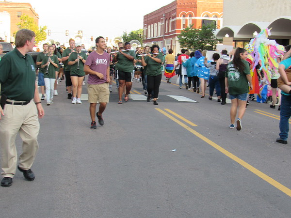 CATHY SPAULDING/Muskogee Phoenix The Pride of Muskogee Band passes the Muskogee Gay-Straight Alliance and other Muskogee High School groups after doing a U-turn on Broadway during the MHS Homecoming parade Tuesday night.
